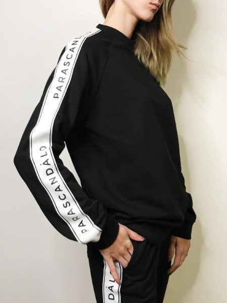 Women wearing logo taped sweatshirt.